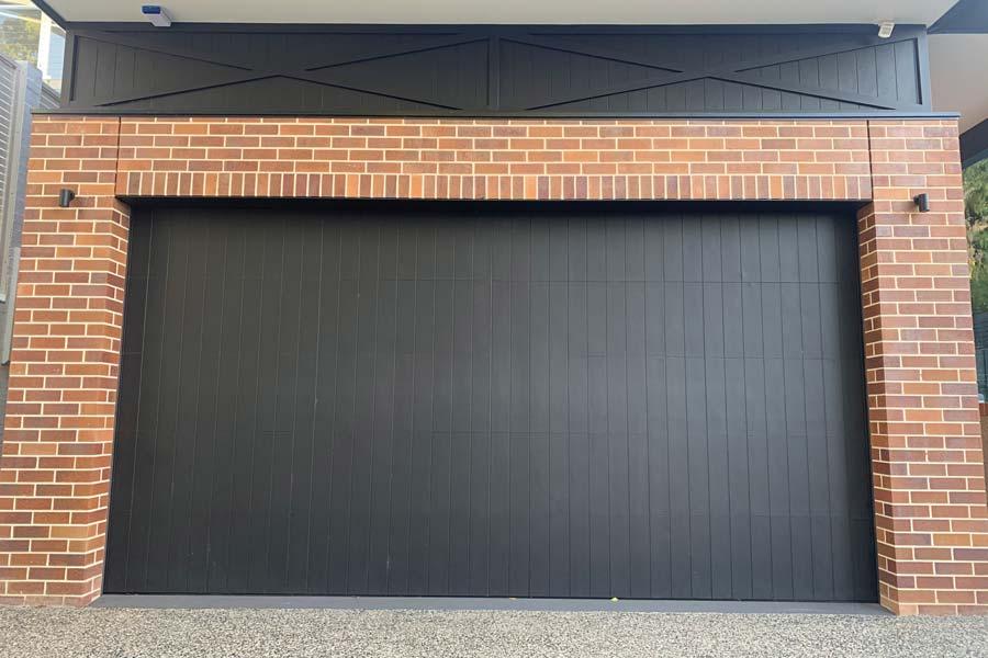 Custom Black Delta Door with Vertical Cladding
